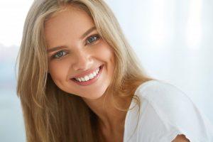 pretty woman smiling perfect teeth