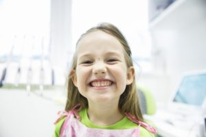 Young girl smiling after sedation dentistry in Norman.