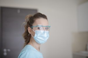Dentist wearing personal protective equipment.
