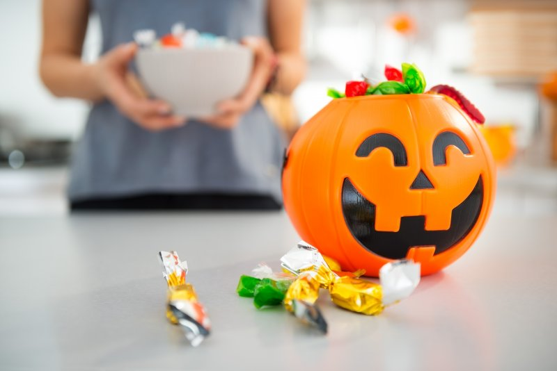 Close up of plastic pumpkin filled with candy