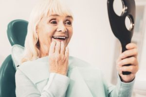 older woman happy with new dentures