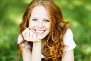 Woman with dental implants enjoying summer